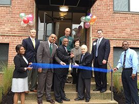ROSS Management Services team cutting ribbon at Overlook Apartments
