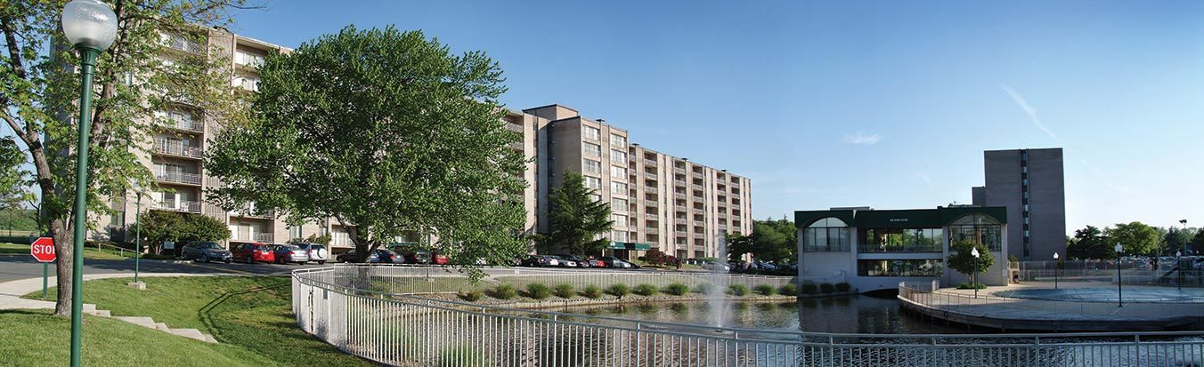 Seven Springs Apartments exterior next to lake