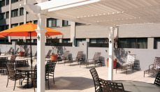 Colesville Towers outdoor lounge w/ tables and chairs