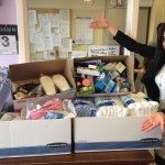 Forest Oak Apartments volunteer with donation boxes