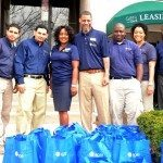 ROSS Companies volunteers in front of gift bags for the CASA