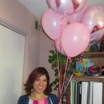 ROSS Companies Employee Holding Balloons to Celebrate Think Pink Office Week