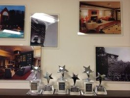 ROSS Management Services' 6 Marketing & Advertising Excellence Awards Trophies