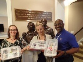 ROSS Companies Employees Hold Donation Boxes Intended for Fisher House