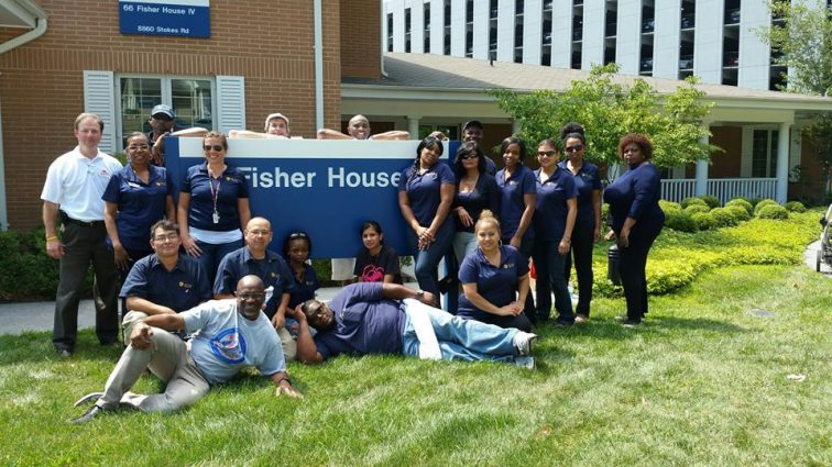 ROSS Companies Employees Pose in Front of Fisher House While Volunteering