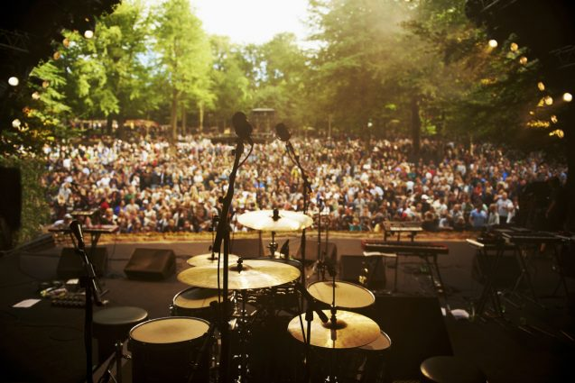 Shot of musical instruments on a stage looking out over a huge crowd