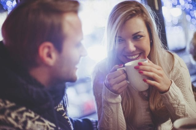 Couple in love, hanging out in coffee shop.